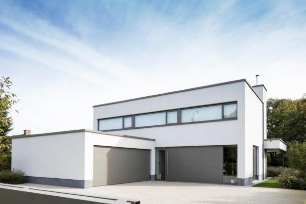 Moderne woning met gevelbepleistering in crepi (Eksaarde)